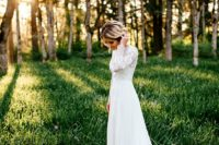 09 a long sleeve wedding dress with a textural lace bodice, a plain skirt with a train