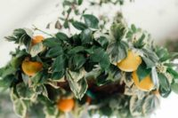09 a lush foliage and orange chandelier will make your venue more eye-catching and gorgeous