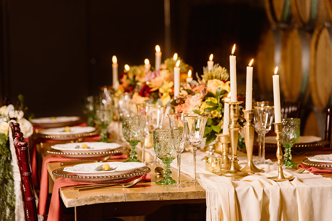 Lush florals, sparkly chargers, coral napkins and green glasses became a great combo for a fall tablescape