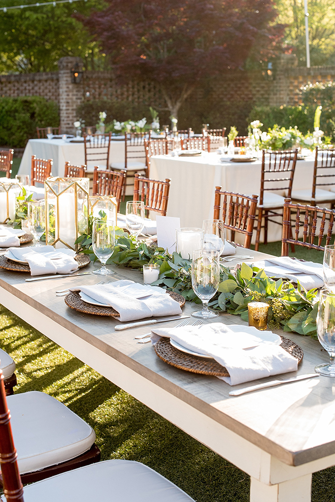 Picture Of The wedding table setting was done with a greenery garland candles and wicker chargers & Picture Of The wedding table setting was done with a greenery ...