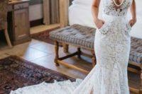 10 a sleeveless lace mermaid wedding dress with a deep V neckline, pockets and a train