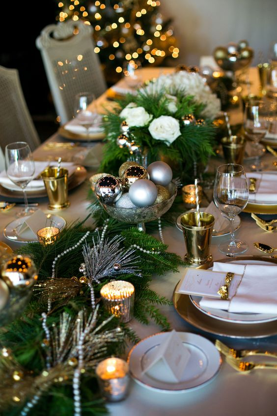 a wedding centerpiece of different metallic ornaments in a bowl is easy to make