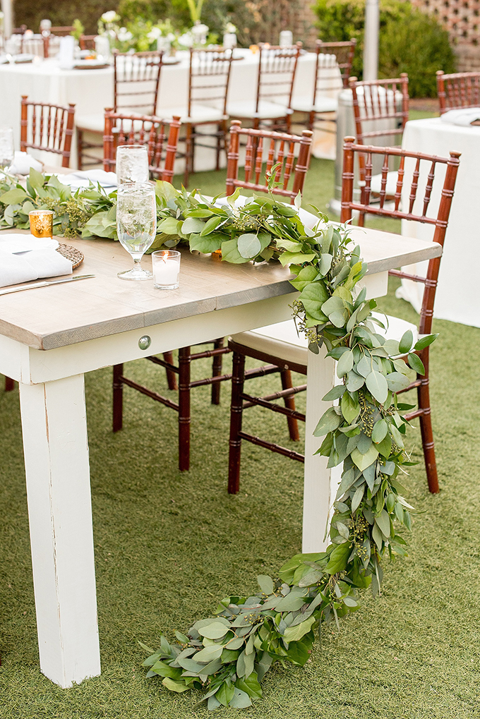 Lush greenery garlands are sure to make the tablescape fresh and natural