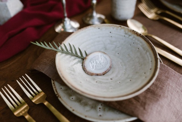 The plates were do earthy and gold cutlery added a chic touch