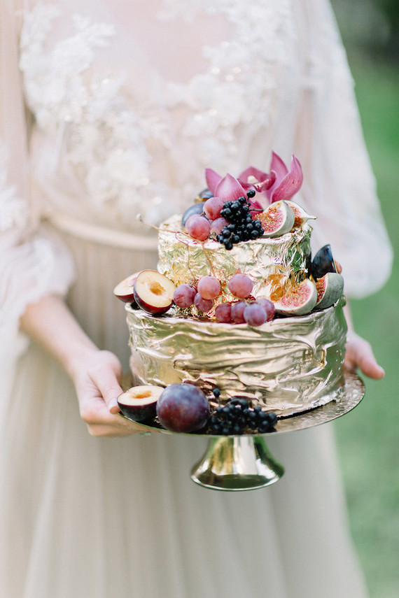 The wedding cake was a metallic gold one with a texture and topped with fresh fruit and berries
