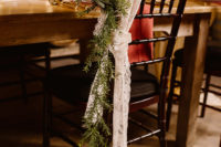11 The wedding chairs were decorated with lace, greenery and white roses