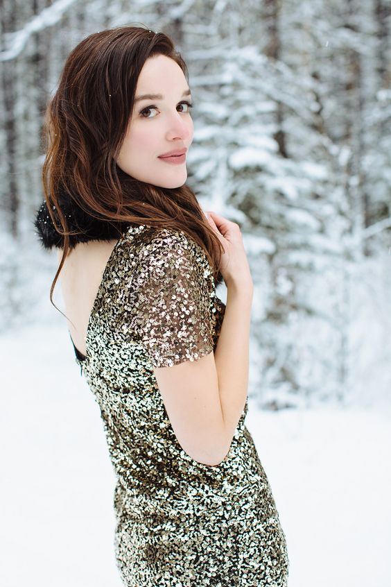a beautiful sequin dress with a faux fur scarf for a chic and girlish look