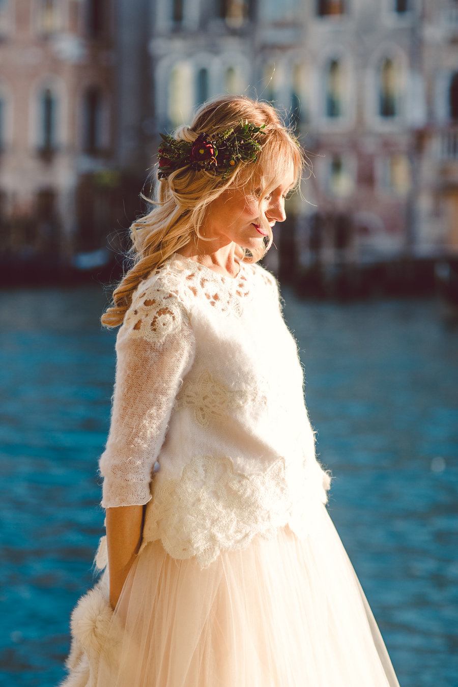 a bridal separate with a warm white top with crochet lace and a layered skirt