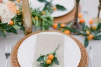 11 a chic table runner with foliage and kumquats, and fresh kumquats for markign every place setting