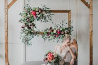 11 a wedding lounge with a refined daybed and a hanging frame with lush blooms for shooting weddign portraits