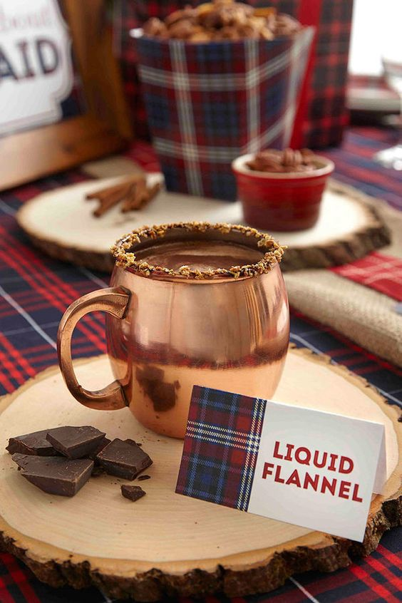 rock copper mugs and wood slice coaters for your hot cocoa station to give it a cute rustic look