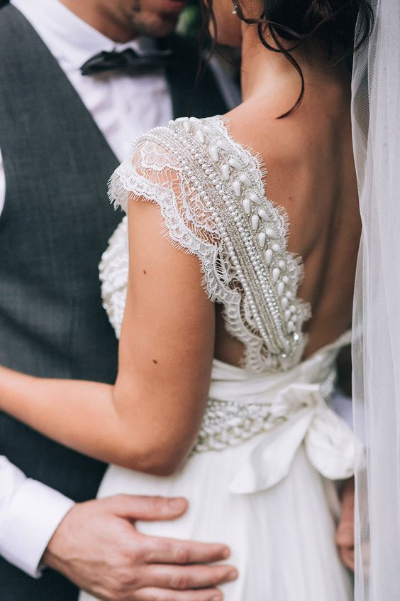 wide straps of lace with pearls and beads look very refined and you won't need other accessories