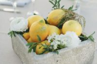 12 a concrete box with lemons, foliage and white blooms for a modenr tropical wedding