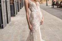 12 chic textural plunging neckline sleeveless wedding dress with a fit and flare silhouette