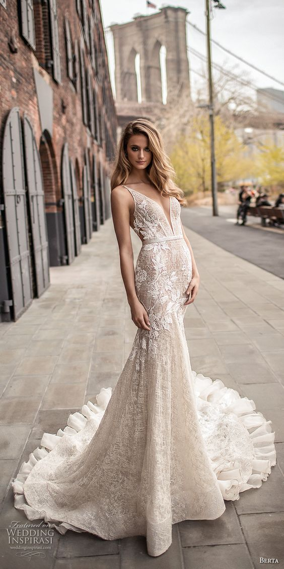chic textural plunging neckline sleeveless wedding dress with a fit and flare silhouette