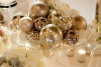 12 different silver ornaments on a glass plate can become a great winter wedding centerpiece