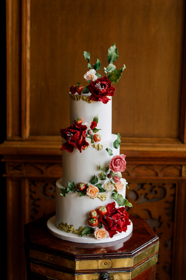 The wedding cake was a pure artwork, with flowers and strawberries on it and looked very whimsy
