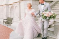 13 a blush wedding gown with an illusion neckline, long sleeves and white lace appliques