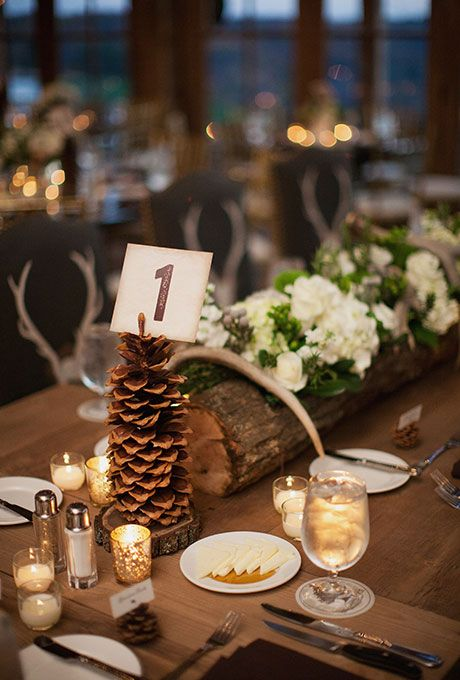 a large pinecone table number holder will bring a rustic feel to the table