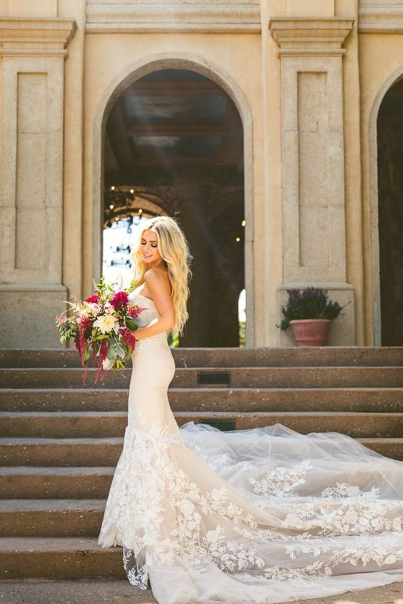 a sexy strapless mermaid wedding dress with a lace applique train