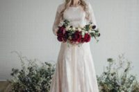 14 a blush wedding dress with white lace appliques, a train and long sleeves looks feminine