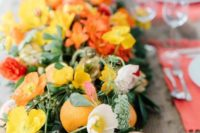 14 a lush table runner with oranges, pomegranates, orange annd yellow blooms looks very bold