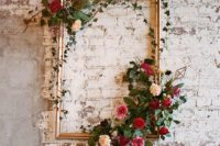 15 a vintage picture frame decorated with greenery and blooms will be a nice artwork for your venue