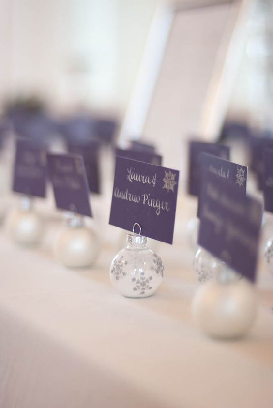 tiny Christmas ornaments with faux snow inside are amazing for displaying escort cards