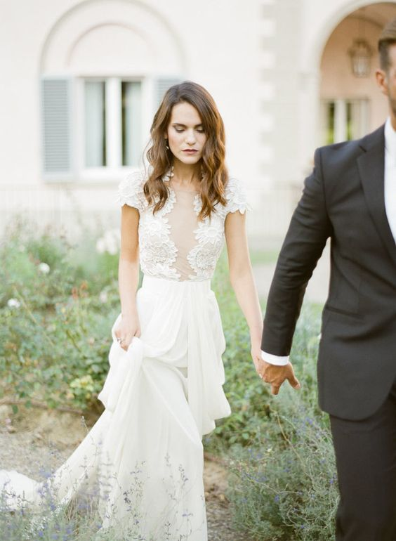a chic and feminine wedding gown with a lace bodice, cap sleeves and an illusion plunging neckline