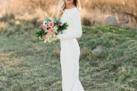 16 a plain modern wedding dress with long sleeves and a lace train to stand out