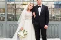 16 a scoop neckline wedding dress with a lace bodice and sleeves and a plain full skirt is great for a cold weather wedding