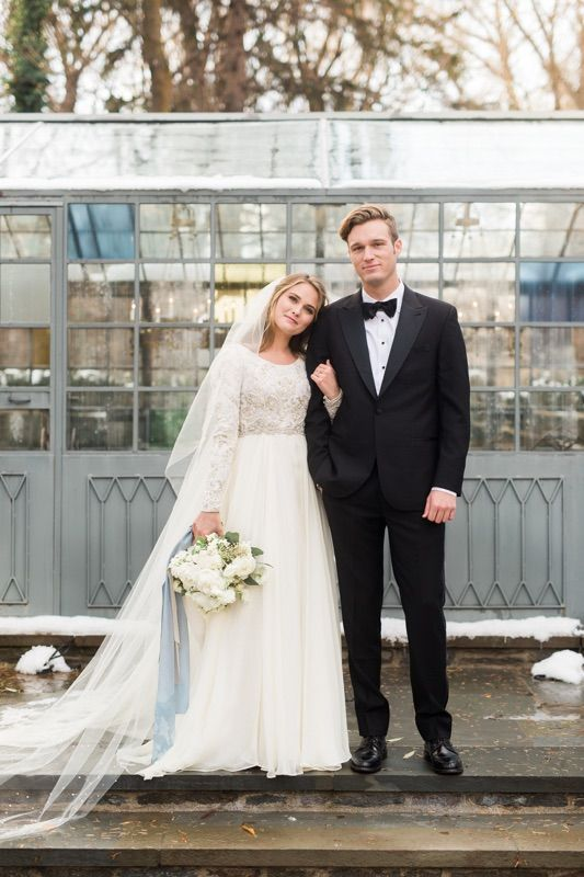 a scoop neckline wedding dress with a lace bodice and sleeves and a plain full skirt is great for a cold weather wedding