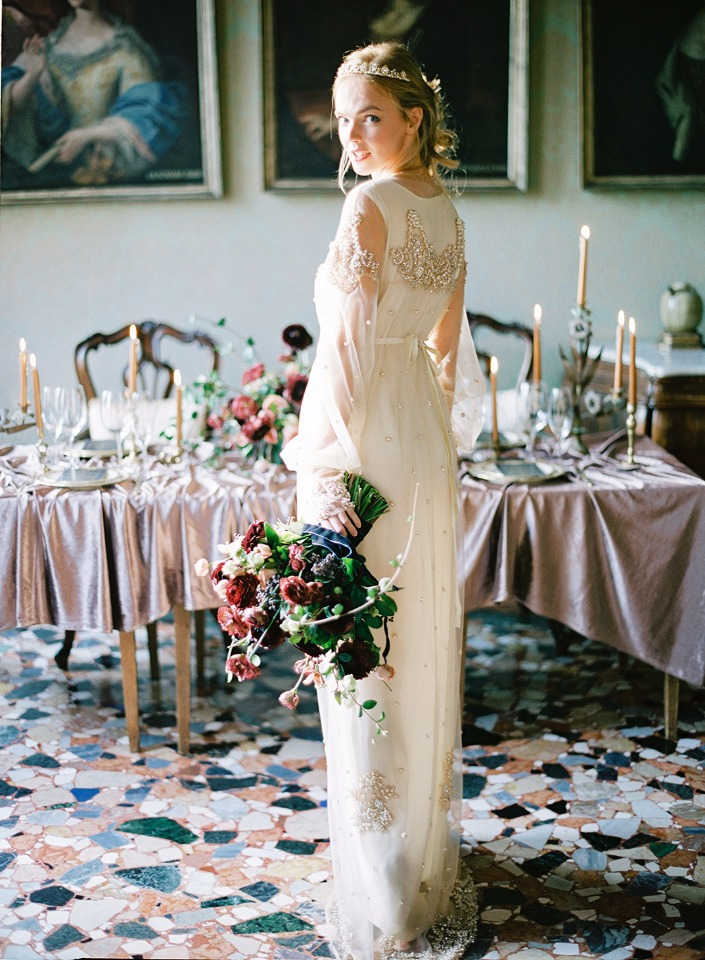 an embellished wedding dress with illusion sleeves and a modest neckline