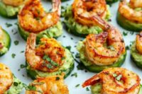 16 blackened shrimp avocado bites with fresh greenery is a healthy and tasty idea