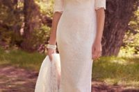 17 a modest lace wedding dress with half sleeves and a long train