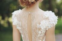 17 an ethereal sheer lace back with lace appliques and a cutout