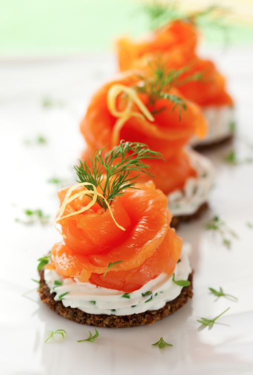 crackers with cream cheese, dill, parsley and smoked salmon for a fresh and tasty snack