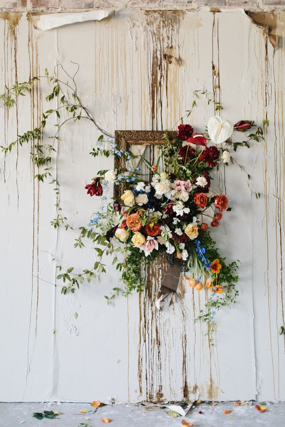 a cool vintage frame with lush colroful blooms with greenery will be a nice decoration for spring or summer