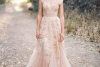 18 a sleeveless blush pink wedding dress with lace appliques and a deep V-neckline lookf super chic