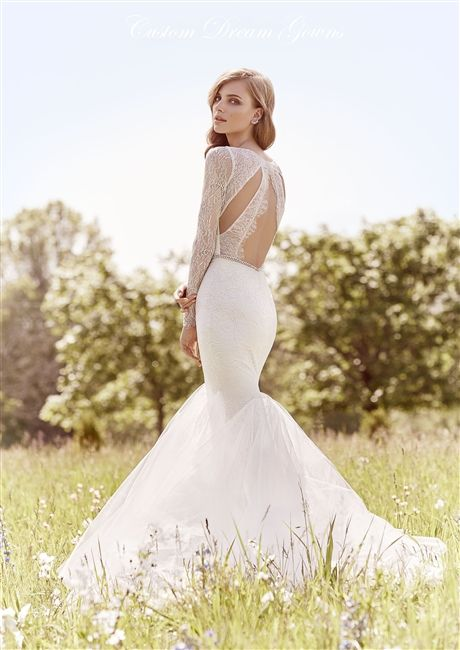 a unique mermaid wedding dress with a lace bodice, a cutout back, long sleeves