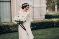 18 a wedding dress with three quarter sleeves, a textural lace bodice and a flowy and airy layered skirt