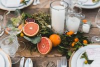 18 stylish wedding table decor with foliage, citrus and some candles in the center of the table