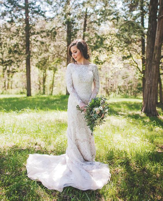 high neckline long sleeve wedding dress with a train and lace appliques is a chic and timeless idea
