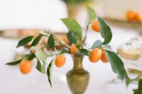 19 some kumquats in a vintage vase can become a chic vintage-inspired centerpiece