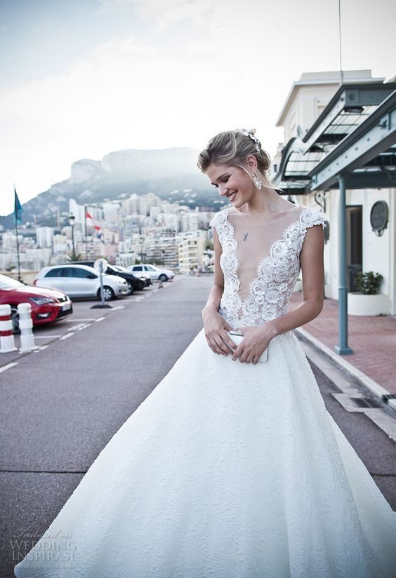 A-line wedding dress with cap sleeves, a boho lace bodice with an illusion plunging neckline and a textural skirt