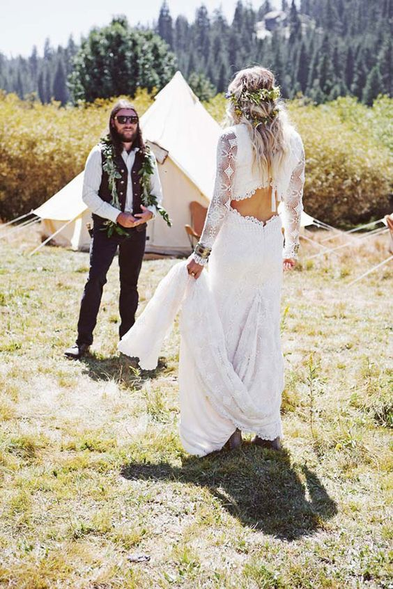 a boho lace wedding dress with long sleeves, a whimsy cutout back and a train