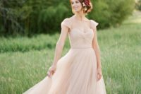 20 a simple romantic wedding gown with cap sleeves, a sweetheart neckline and a layered skirt