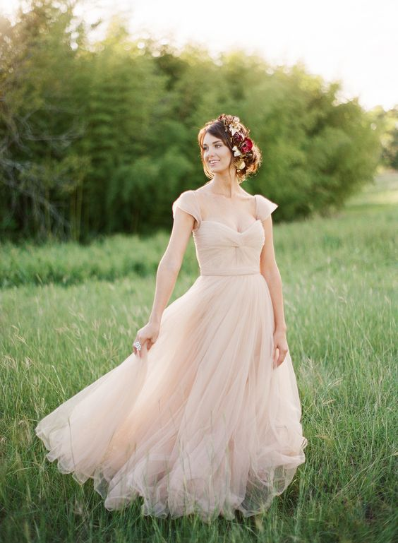 Picture Of a simple romantic wedding gown with cap sleeves, a ...