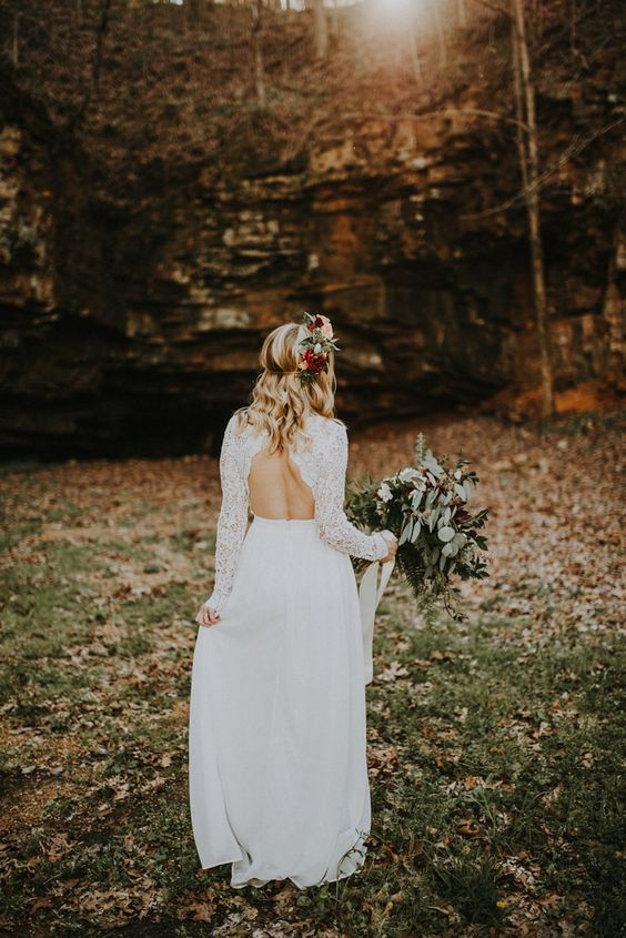 a boho wedding dress with a lace bodice, long sleeves and a cutout back, a plain skirt
