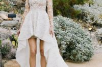21 a lace applique high low wedding dress with a train, illusion sleeves and a modest neckline
